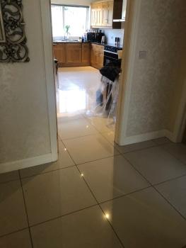 Find a leak under tiled floor